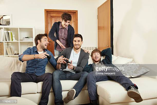 Young men playing indoors video game