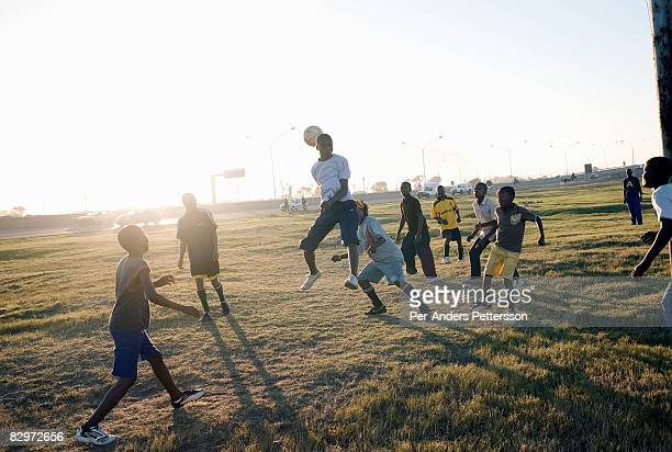 Young men playing soccer