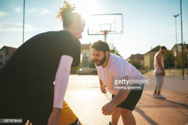 Young Men Playing Streetball