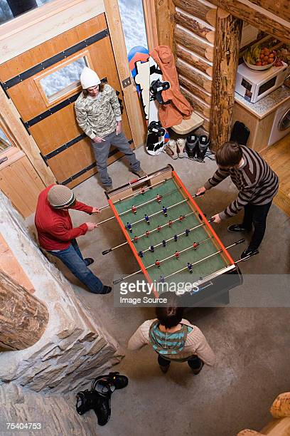 Young men playing table football
