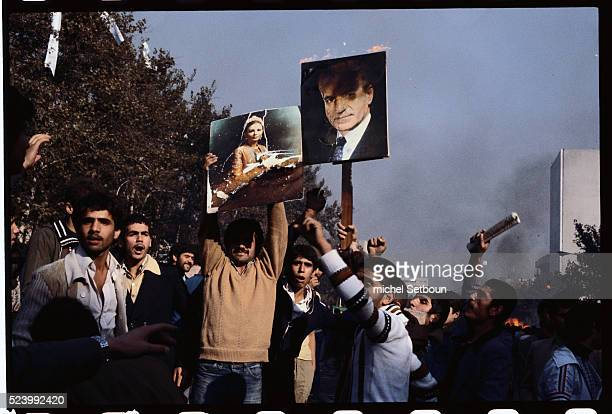 Young men protest against the government of the current Shah Mohammed Reza Pahlavi The Shah's government was overthrown in October in favor of an...
