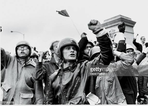 Young men raise their fists and chant slogans during the 'Days of Rage' demonstrations organized by the Weathermen to protest the Chicago Seven trial...