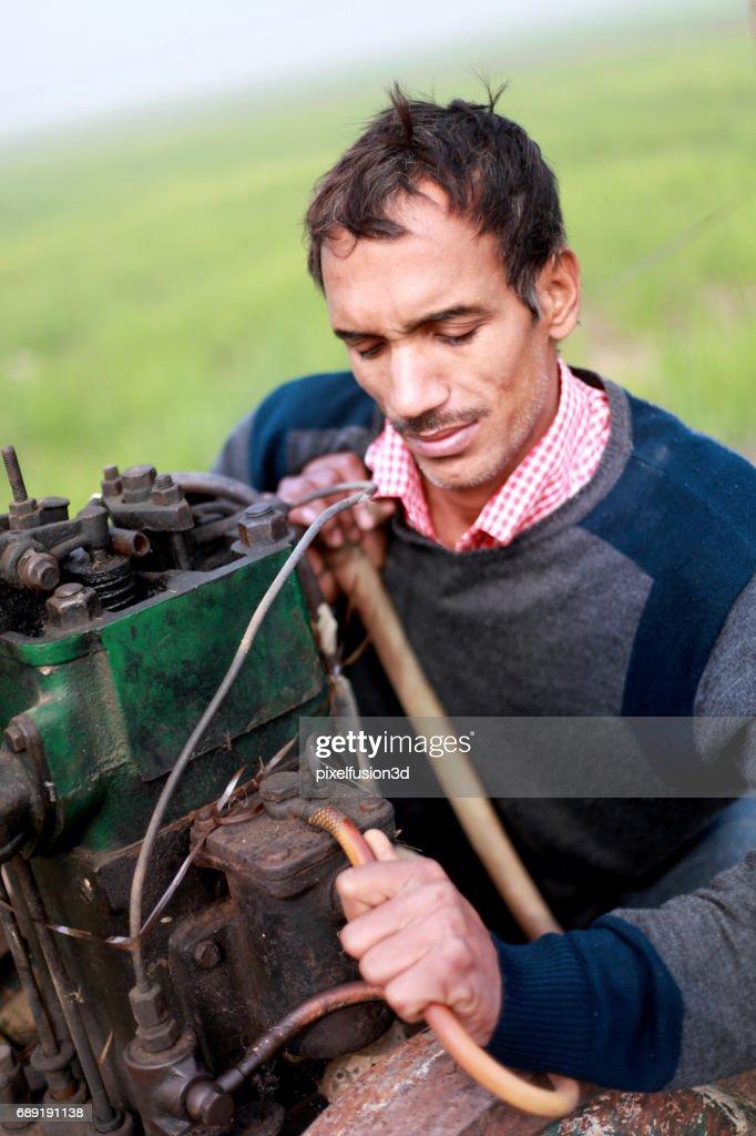 Young men repairing engine : Stock Photo