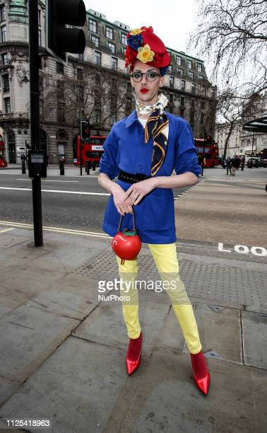 Young men seen on a street in front of London Fashion Week show space on February 16, 2019 in London, England. Members of public who attend the shows...