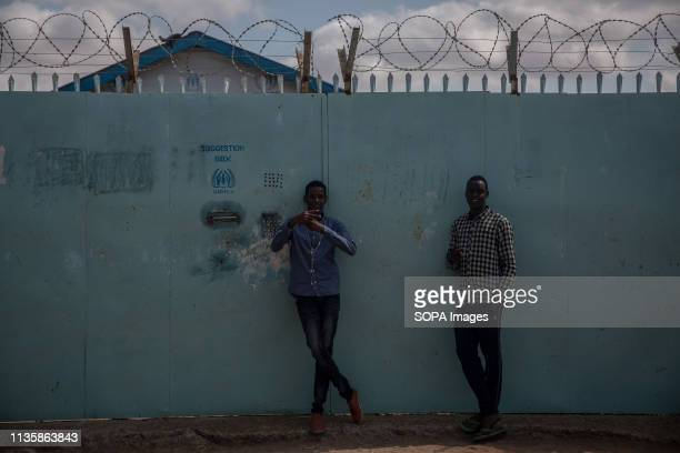 Young men seen standing in front of a UNHCR field office in the refugee camp. Dadaab is one of the largest refugee camps in the world. More than...