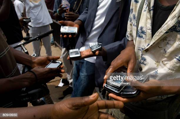Young men sell phones in a busy market corner in Accra November 17 2007 in Ghana Nokia has invested great amounts into researching customer behavior...