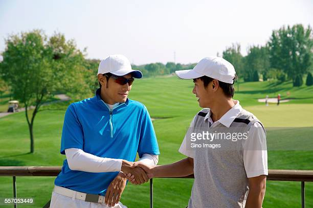 Young Men Shaking Hands