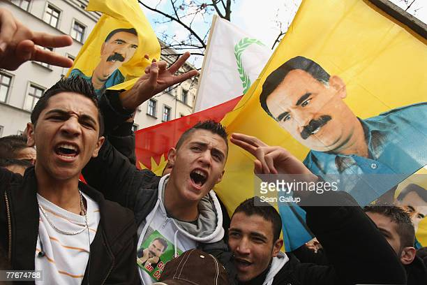 Young men shout and gesture under a portrait of imprisoned Kurdish leader Abdullah Ocalan at a protest of several thousand mostly Kurdish...