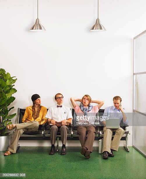 Young men sitting in waiting room (digital composite)