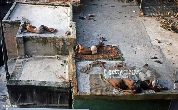 Young men sleeping on rooftop