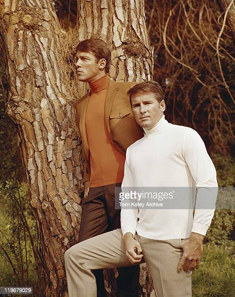 young men standing besides tree - 1971 stock pictures, royalty-free photos & images