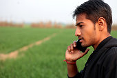 young men asian ethnicity standing field