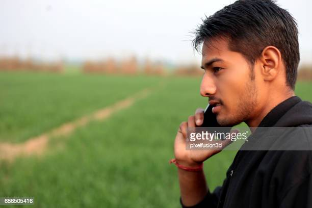 Young men talking on mobile phone