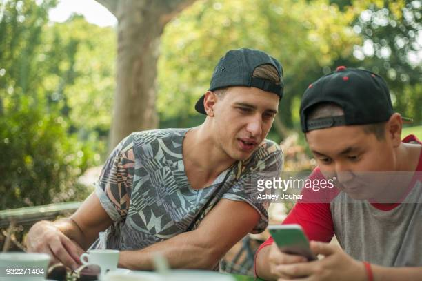 Young men texting on smartphone, Budapest, Hungary