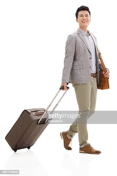 young men travel - wheeled luggage stock photos and pictures