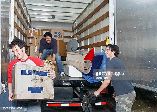 Young men unloading moving van