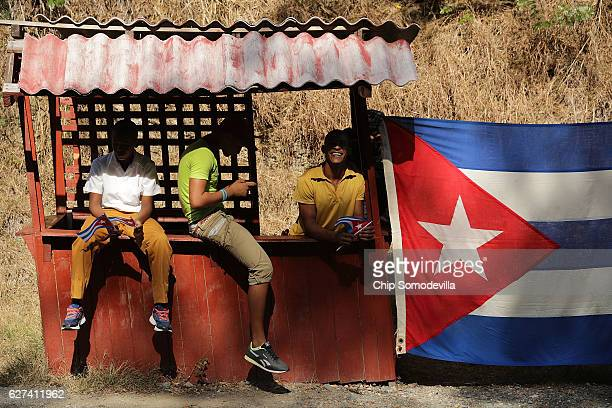 Young men wait by the side of the road for the remains of former Cuban President Fidel Castro to pass by on their fourday journey across the country...