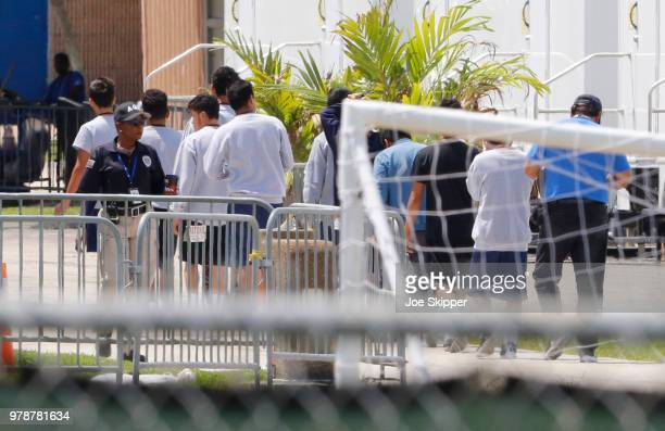 Young men walk in line under the watch of a security officer before US Sen Bill Nelson and US Rep Debbie Wasserman Schultz were denied access to the...