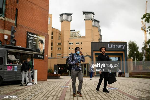 Young men walk past Coventry University Library as they leave a campus building at the beginning of the new academic year, at Coventry University, in...