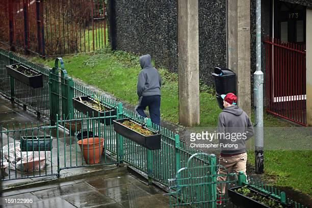 Young men walk through the Falinge Estate which has been surveyed as the most deprived area in England for a fifth year in a row on January 8 2013 in...