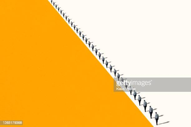 young men walking in row with shadows - repetition stock pictures, royalty-free photos & images