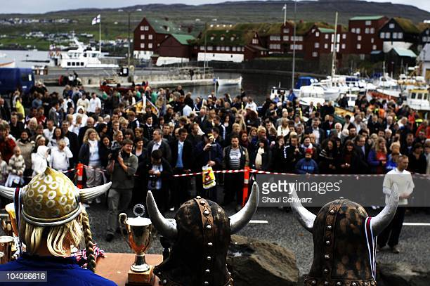 Young men wear viking horns as they receive medals after the rowing competitions during St Olav's Day The National Festival in Torshavn the capital...