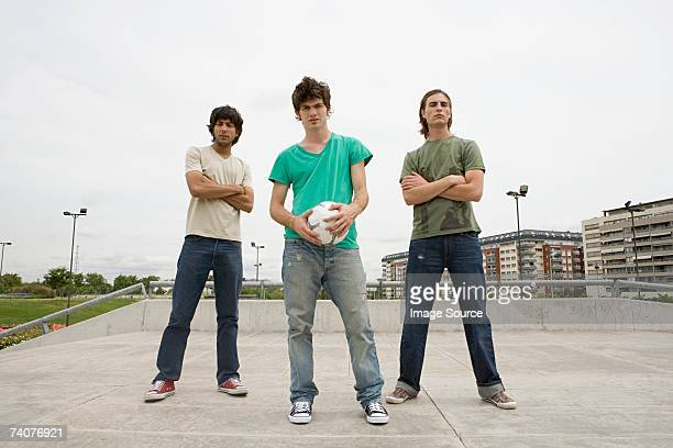 Young men with football