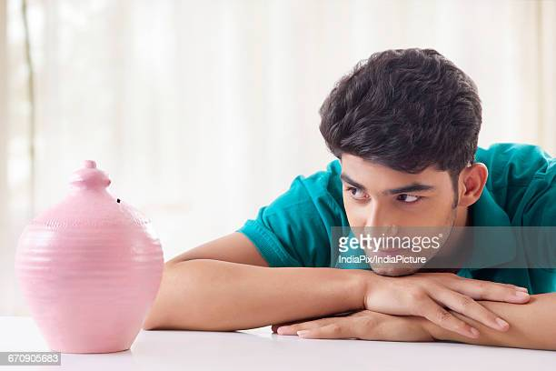 Young Men with money bank