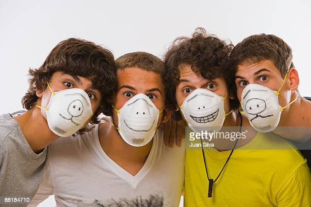 young men with protective masks with animal faces - funny surgical mask stock pictures, royalty-free photos & images