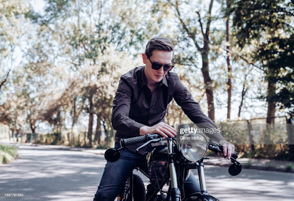 Young Men With Sunglasses Sitting On Vintage Custom ...