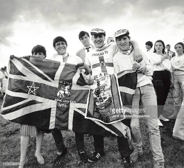 Young men with their flag during the annual Orange Order march in Liverpool, circa July 1982. The parades typically build up to 12 July celebrations...