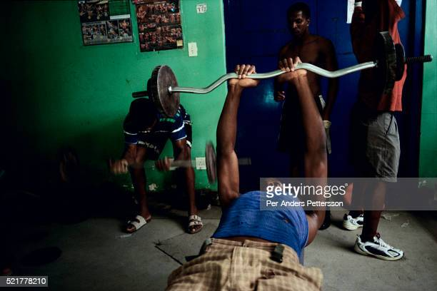 Young men work out in a gym in Khayelitsha, the biggest black township, about 20 miles outside Cape Town, South Africa. It's estimated that over one...