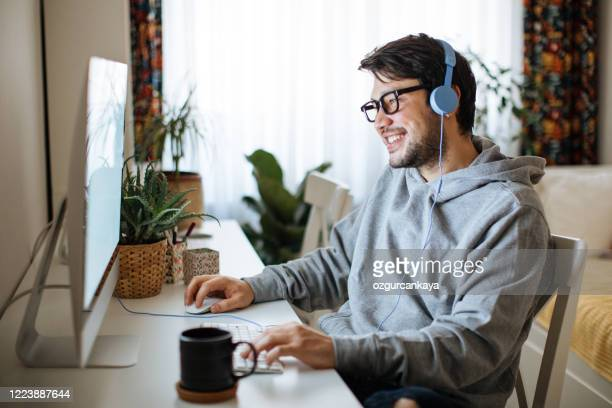 young men working from home - esports stock pictures, royalty-free photos & images