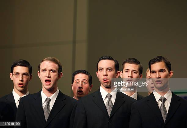 Young men's choir sings.