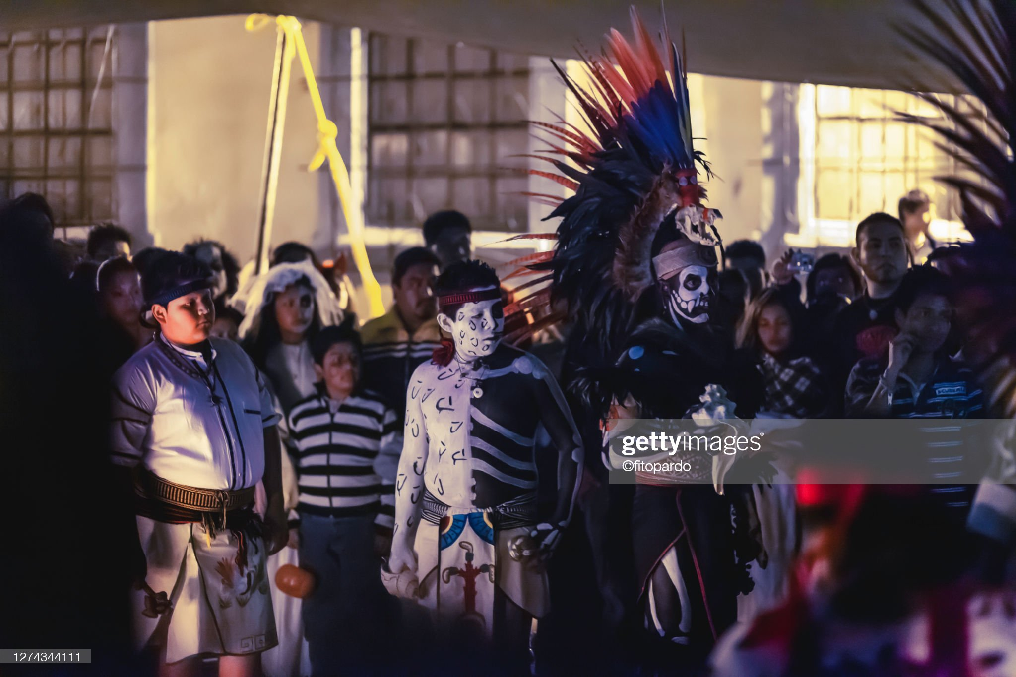 Young Mexican Aztecs Watch the dance dance in the Day of The Dead in Mixquic Mexico : Stock Photo