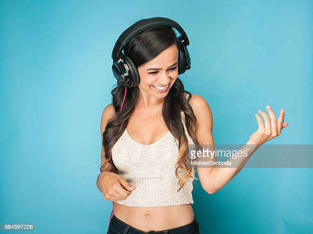 Young Mexican Women Dancing With Headphones