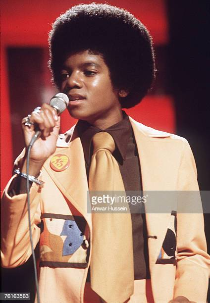 A young Michael Jackson performs live with the Jackson 5 in February 1975 in London England