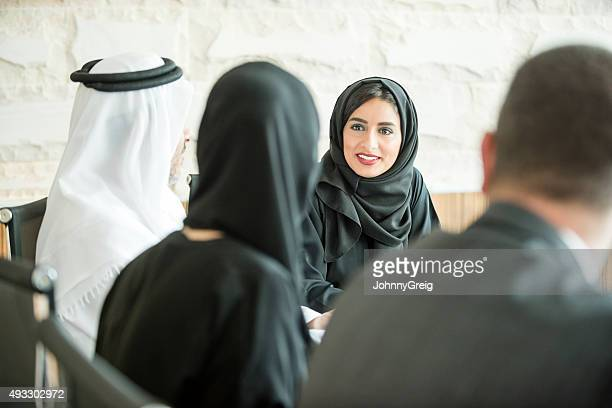 young middle eastern businesswoman in business meeting - united arab emirates stock pictures, royalty-free photos & images