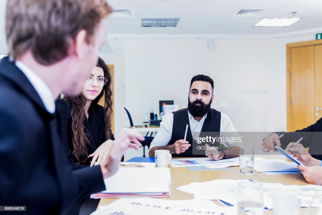 young middle eastern entrepreneur chairing a business meeting stock