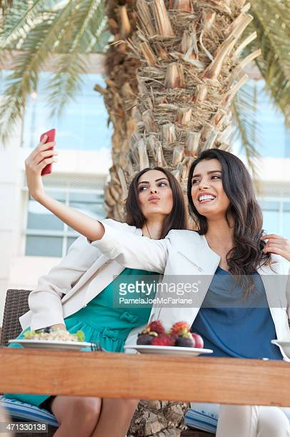 Young Middle Eastern Women Making Faces and Posing for Selfie