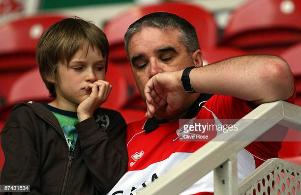 A young Middlesbrough fan and his father react after the final whistle at the Barclays Premier League match between Middlesbrough and Aston Villa at...