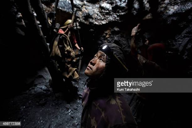 A young migrant coal miner from Nepal looks up from a mine hole in Jaintia Hills Meghalaya in India on April 30 2014 Indian government announced in...