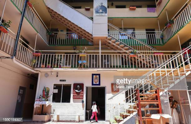 Young migrant enters the dining area in the Casa del Migrante shelter for migrants, Tijuana's oldest shelter, on July 22, 2021 in Tijuana, Mexico....