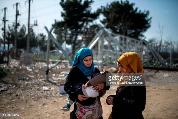 TOPSHOT Young migrant women from Syria look on after crossing the GreekMacedonian border near the town of Gevgelija on February 23 2016 Greece has...