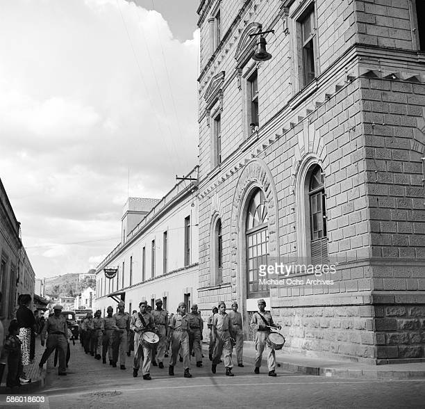 Young military boys march down a city street in Tegucigalpa Honduras