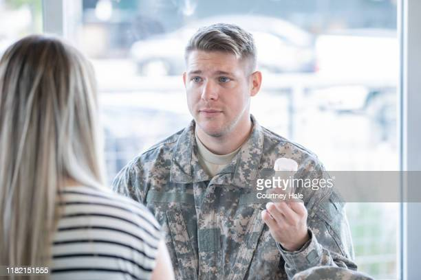 young military man struggling with mental illness talk with counselor - post traumatic stress disorder stock pictures, royalty-free photos & images