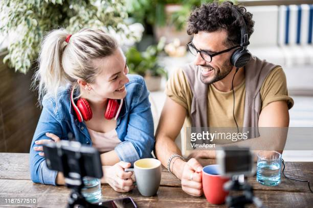 young millenial couple sharing creative content