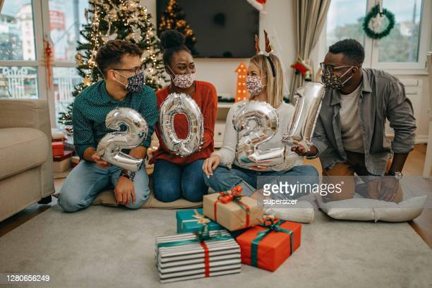 young millenials celebrate new year under covid - new year's eve stock pictures, royalty-free photos & images