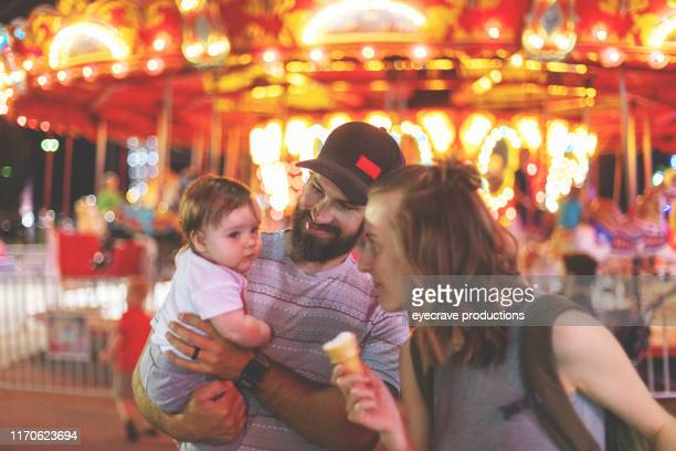 Young Millennial family enjoying their time at the Empire State Fair in Springfield MO on a hot July summer night