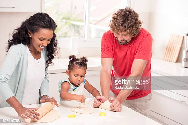 Young mixed family backing together.